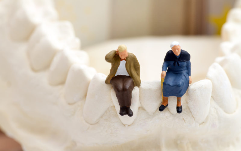 Two elderly people sitting on a jawbone